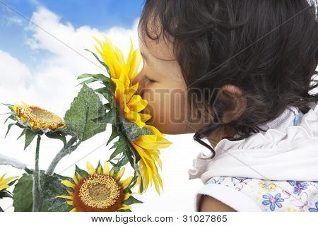 Cute Girl Smelling Sunflowers
