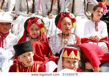 Children watch as the dance