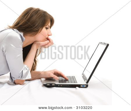 Beautiful Businesswoman With A Laptop Working. White Screen In Pc