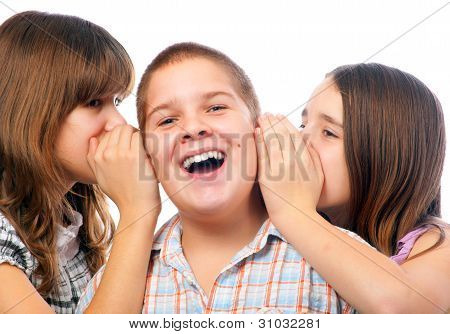 Two girls and a boy gossiping