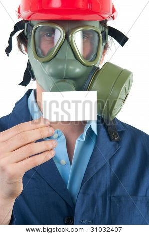 Professional with gas mask and helmet holding business card with place for your text isolated on whi