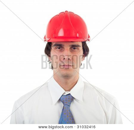 Portrait of engineer wearing white shirt, blue tie and red helmet isolated on white
