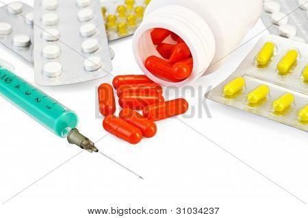 Capsule Red With Drugs And A Syringe