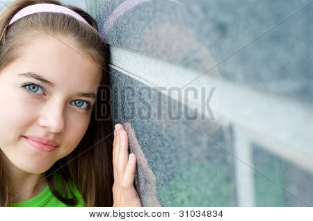 Young Girl Hugs The Wall