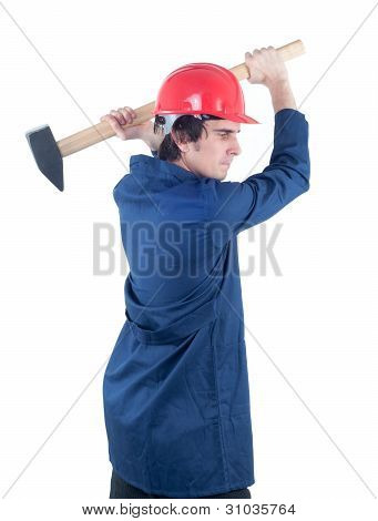 Worker hitting with heavy mallet isolated on white