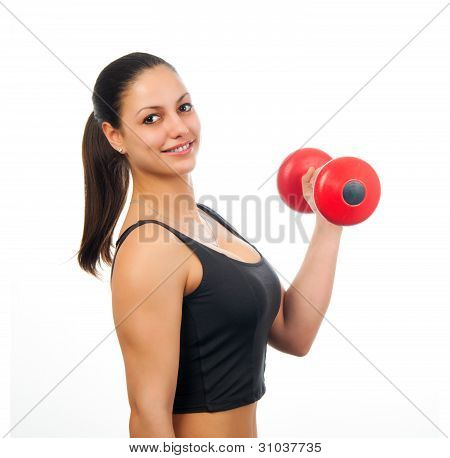 Young attractive woman exercising with red dumbbell isolated on white