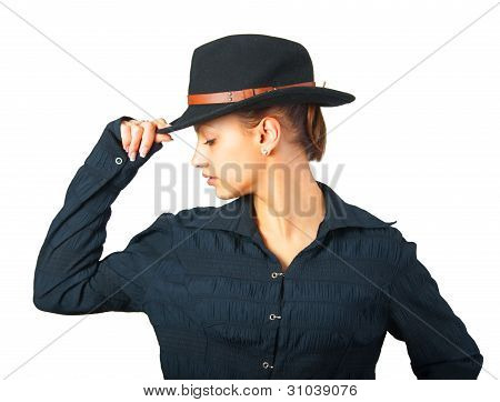 Profile of the beautiful girl in black shirt and black hat
