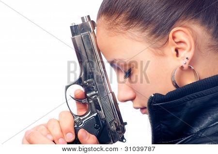 Portrait of beautiful girl in black leather jacket holding beretta gun in her hands isolated on whit