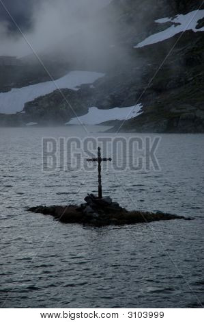 Holy Cross On A Foggy Alpine Pond