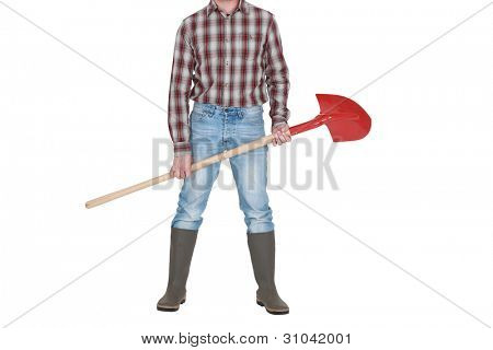 A cropped picture of a construction worker holding a shovel.