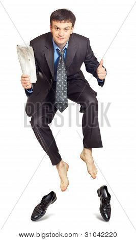 Businessman Jumping With Newspaper In Hand