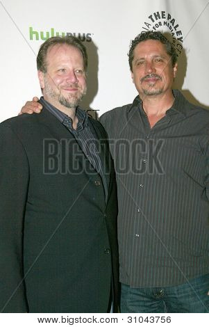 """BEVERLY HILLS, CA - MARCH 9: """"Castle"""" creator Andrew W. Marlowe and director Rob Bowman arrive at the 2012 Paleyfest """"Castle"""" panel on March 9, 2012 at the Saban Theater in Beverly Hills, CA."""