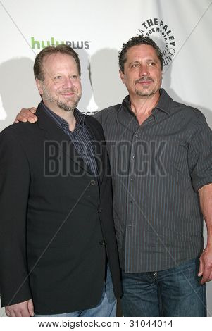 "BEVERLY HILLS, CA - MARCH 9: ""Castle"" creator Andrew W. Marlowe and director Rob Bowman arrive at the 2012 Paleyfest ""Castle"" panel on March 9, 2012 at the Saban Theater in Beverly Hills, CA."