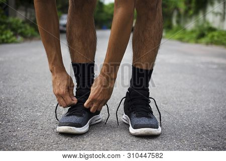 poster of Runners Tied In Shoes,man Run On The Street Be Running For Exercise,run Sports Background And Closeu