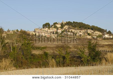 old village perched on a hill, France