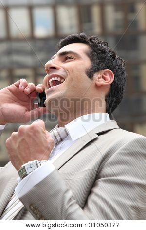 Man guffawing on phone