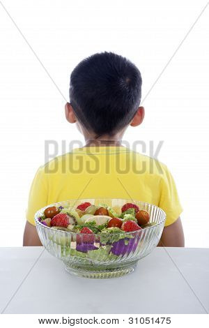 Backside Of Boy With Salad