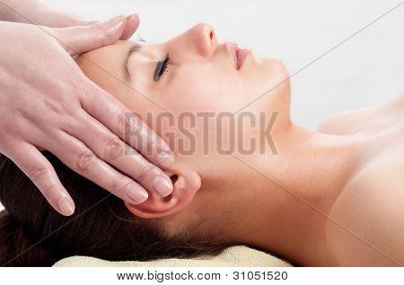 Beautiful young women getting a face massage