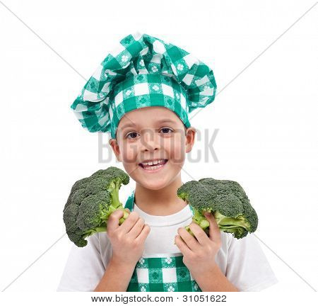 Happy chef with hat and apron holding broccoli - isolated