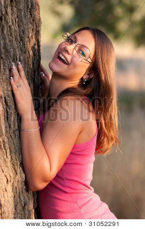 Beautiful young women smiling while posing outdoor