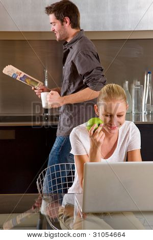 Couple At Home Woman Using Laptop