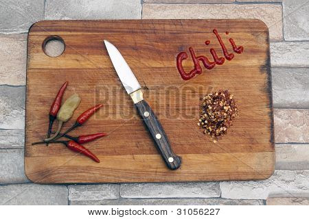 Hot Chili Papers On A Cutting Board