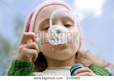 Little Girl Starts Up Soap Bubbles