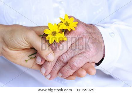 Senior & Young Ladies Holding Hands
