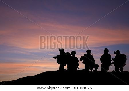 Silhouette Of Modern Troops In Middle East Silhouette Against Beautiful Sunset Sky