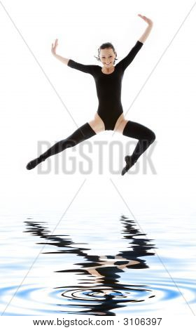Girl In Black Leotard Jumping Over Water