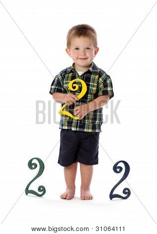 A Two Year Old Holds a Number Two