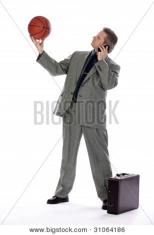 Business Man Holding a Basket Ball and Cell Phone