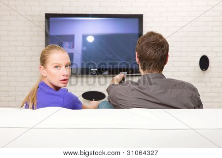 Man Watching Tv Woman Looking Back