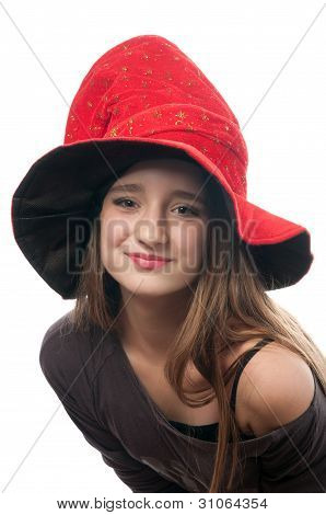Pretty teenage girl in witch costume