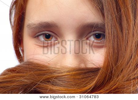 Face of the beautiful teenage girl with accent on her eyes and her hair