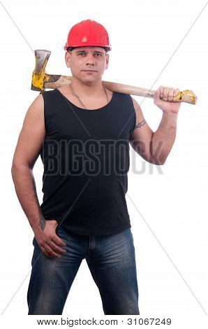 Proud lumberjack posing with red helmet on his head and big old ax on his shoulder