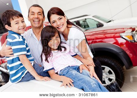 Family out shopping for a new car at the dealership