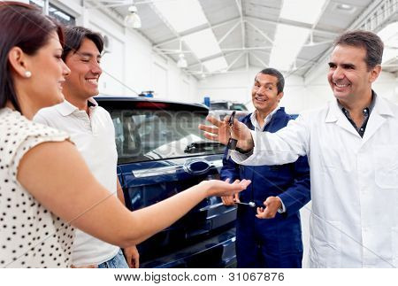 Couple taking car to the repair shop to be fixed