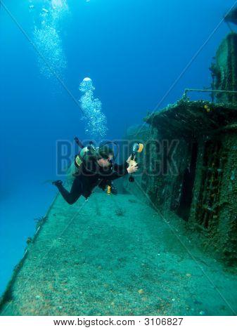 Underwater Photographer Shooting A Sunken Ship