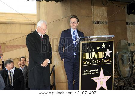 LOS ANGELES, CA - MAR 16: Malcolm McDowell, Gary Oldman at a ceremony where Malcolm McDowell is honored with a star on the Hollywood Walk of Fame on March 16, 2012 in Los Angeles, California