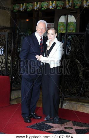 LOS ANGELES, CA - MAR 16: Malcolm McDowell, wife Kelley at a ceremony where Malcolm McDowell is honored with a star on the Hollywood Walk of Fame on March 16, 2012 in Los Angeles, California