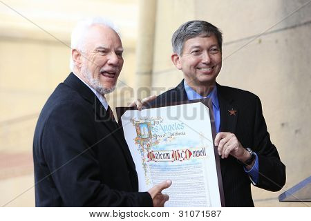 LOS ANGELES, CA - MAR 16: Malcolm McDowell, Leron Gubler at a ceremony where Malcolm McDowell is honored with a star on the Hollywood Walk of Fame on March 16, 2012 in Los Angeles, California