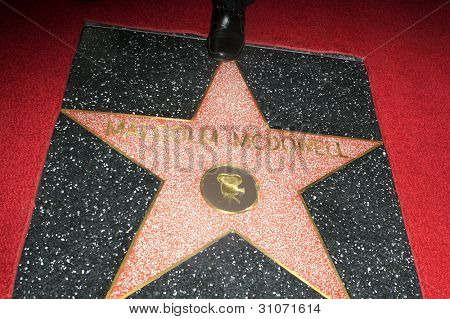 LOS ANGELES, CA - MAR 16: Malcolm McDowell star at a ceremony where Malcolm McDowell is honored with a star on the Hollywood Walk of Fame on March 16, 2012 in Los Angeles, California