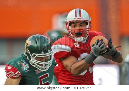VIENNA, AUSTRIA - JULY 15: WR Ryoma Hagiyama (#85 Japan) runs with the ball at the Football World Championship on July 15, 2011 in Vienna, Austria.