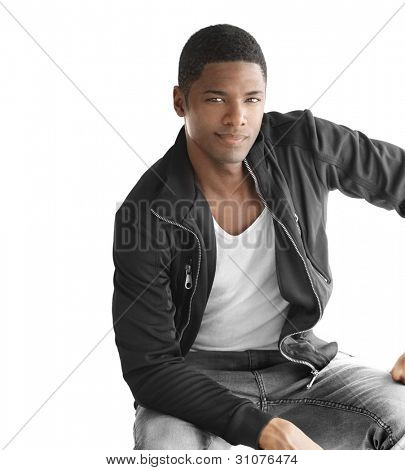 Portrait of a sexy male model in trendy clothes against white background with copy space