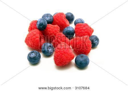 Raspberries And Blueberries Isolated On White