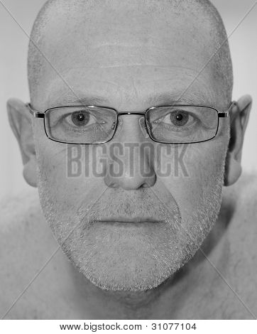 mature man wearing glasses