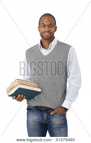 Portrait of smart black university student posing with books handheld, cutout on white.