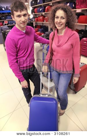 Couple Buys Suitcase In Shop