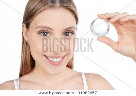 Young happy woman holding crystal ball isolated on white background.